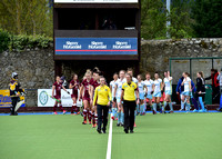 Umpires Gillian Garrett and Alison Keogh lead out the teams