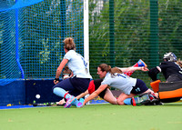 Liz McInerney nudges the opening goal over the line