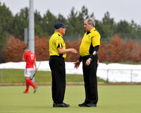 Umpires Crozier Deane and Percy Henchy